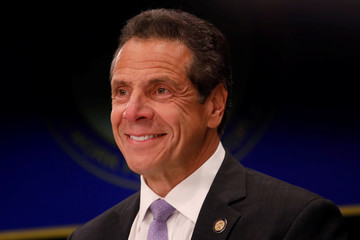 New York Governor Andrew Cuomo smiles during a news conference in New York