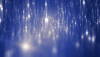 Abstract blue bokeh circles on a black background. Spectacular illustration with particles and rays.