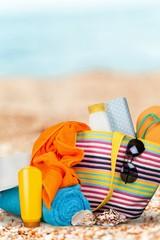 Bag,  flip flops on a tropical beach