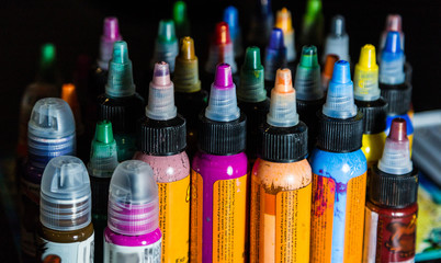 many professional bottles with colored ink for tattoos. tattoo parlor