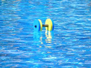 Floating aqua aerobics dumbbell in swimming pool
