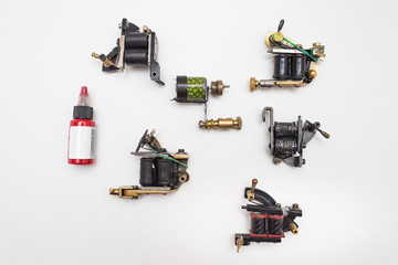 tattoo machine and paint on white isolated background background