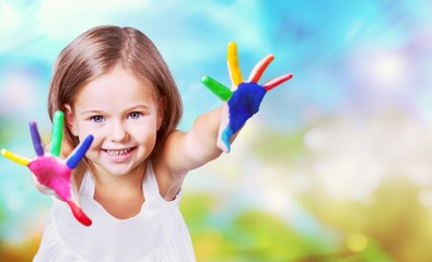 Дittle girl with colorful painted hands