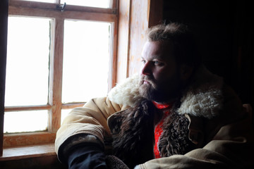 man in traditional winter costume of peasant medieval age in rus