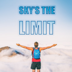 SKY'S THE LIMIT motivation text written on sky background. The sky is the limit for your success. Man with open arms inspirational picture for motivational quote for life challenges. Reach your goals.