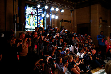 Photographers take pictures at the Pam Hogg catwalk show during London Fashion Week Women's in London