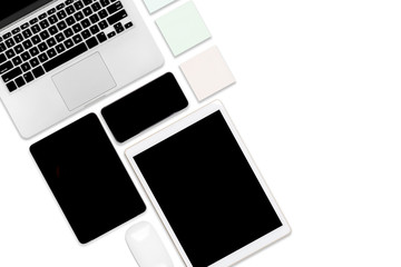 Flat lay photo of office table with laptop computer, digital tablet, mobile phone and accessories. on isolated white background. Desktop office mockup concept.