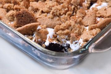Gluten free brownie cookie crumble in glass bakeware