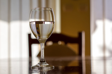 One Wine Glass. Close Up View. Abstract Brown Background.