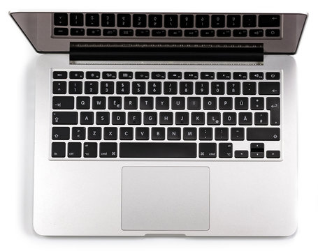Top view of modern retina laptop isolated on white background