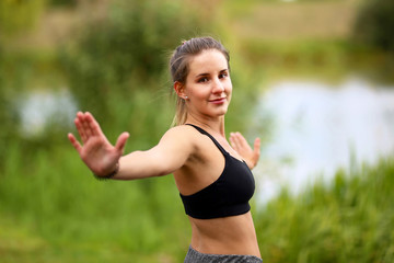 Yoga exercises outdoors / A young girl / Portrait