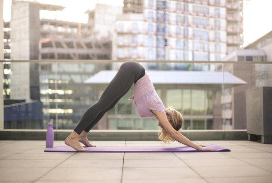 Woman doing yoga on a terrace