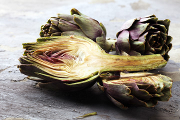 artichokes on grey background. fresh organic artichoke flower.