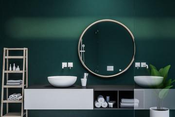 Interior of dark green bathroom, round sink