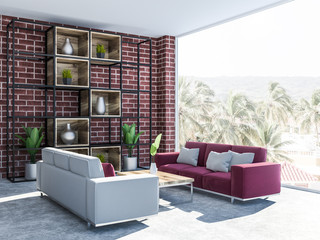 Brick living room interior with couches, side view