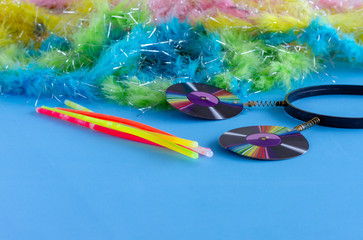 Party props  and Colorful Feather Boas on  blue background - Photo booth Props. Copy Space. Party background