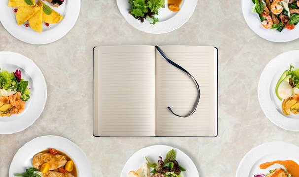 Empty notebook for recipes on lihgt background