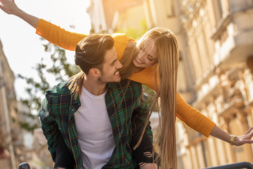 Smiling beautiful couple dating outdoors. Wall mural