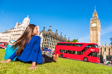 Self adhesive Wall Murals London red bus Happy tourist woman relaxing in London city at Westminster Big ben and red bus. Europe destination travel lifestyl.e