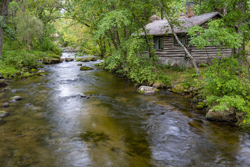 Cabin on the creek Wall mural