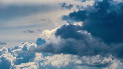 Fotobehang - Epic storm clouds moving fast over blue sky background. 4K UHD Timelapse.