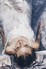 portrait of beautiful woman lying in water with fabric. Fashion concept
