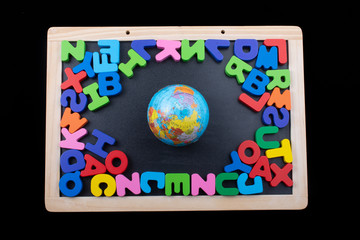 Globe and colorful letters made of wood