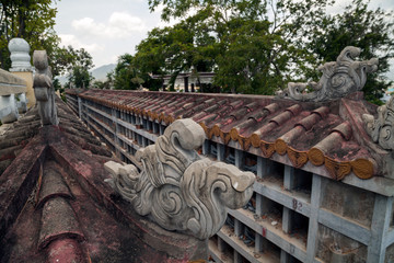 Destroyed traditional Buddhist columbarium in Vietnam. Beautiful decorated Asian cinerary cemetery with empty cells