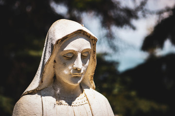 Close up view of religious Christian female statue with blurred background