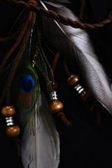 decoration of peacock feathers and wooden beads in hippie style
