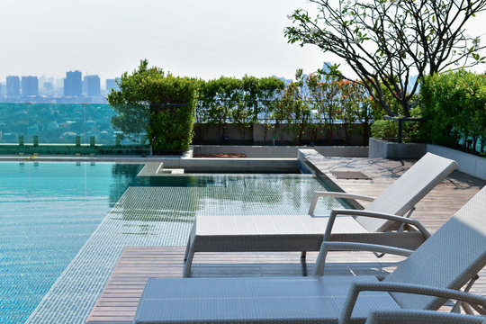 Swimming pool on roof top with beautiful city view at bangkok, thailand.