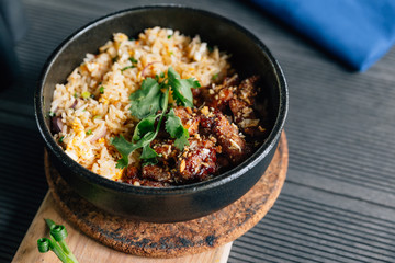 Thai style grilled pork fried rice served with Thai spicy dipping sauce.