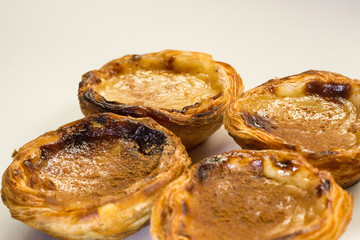 Pasteis de nata or pasteis de Belem is a traditional portuguese dessert from Lisbon. Isolated on a white background