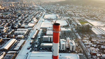 Chimney in winter with industrial city