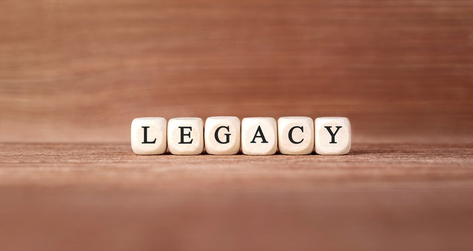 Word LEGACY made with wood building blocks