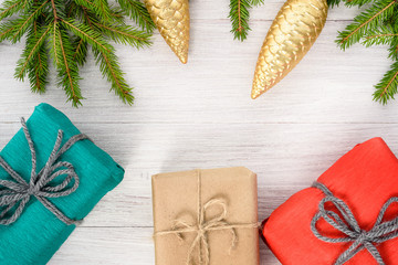 Christmas background - spruce branches, and gifts in a kraft paper package.