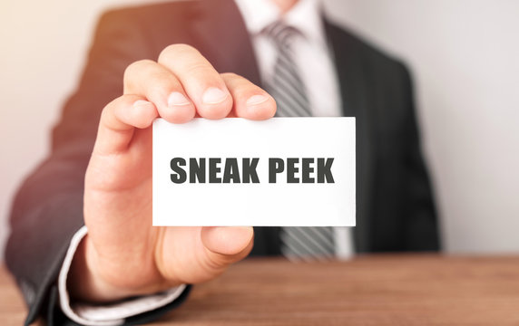 Businessman holding a card with text Sneak Peek