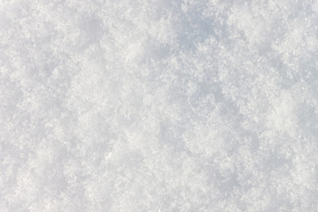 The background is a relief texture made of snow. Hexagonal stars of a snowflake are visible.