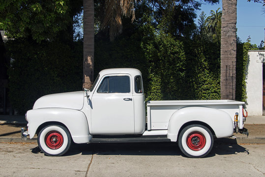 Side view of a vintage classic pick up truck in the street in Los Angeles