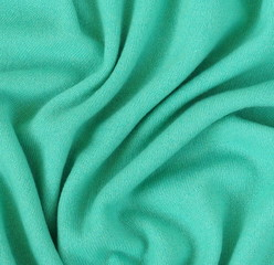 Green cashmere wool background texture , expensive luxury, fabric, material, needlework, sewing,...