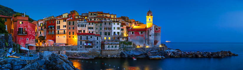 Panorama of night landscape with old scenic sea village Tellaro in La Spezia province, Liguria, Italy