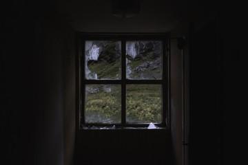 Broken window in an abandoned house, Norway