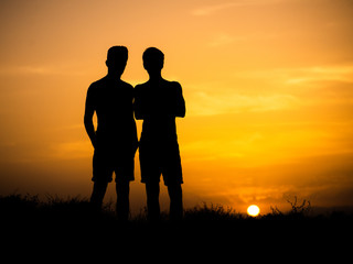 silhouettes of two young friends of the guys