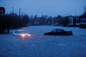 An abandoned car's hazard lights continue to flash as it sits submerged in a rising flood waters after Hurricane Florence struck in Wilmington, North Carolina