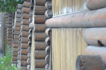 A wooden fence made of logs in medieval style shot from the side view close up.