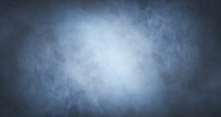Abstract smoke texture over black background. Fog in the darkness.