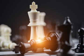 White king in chess game with Concept for company strategy,business victory or decision the path to success.