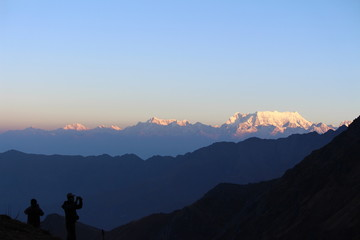 View of Mount Chaukhamba in the Uttarakhand Himalayas, India during sunrise as seen from the hiking trail to Roopkund Lake.