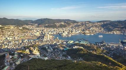 Wall Mural - Timelapse video of Nagasaki city skyline in Nagasaki, Japan time lapse 4K