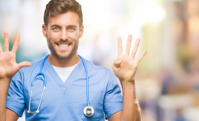 Young handsome doctor surgeon man over isolated background showing and pointing up with fingers number nine while smiling confident and happy.